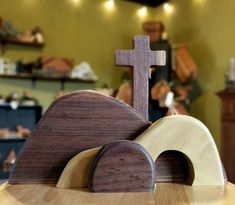 This set-up depicts Golgotha, the Cross and the empty tomb. It is crafted in walnut and sycamore wood.  The biggest Hill in the set up is 5 tall and 12 long. The cross is close to 8 1/2 tall.