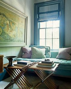 In the library, Gambrel's Turkish sofa is upholstered in Panforte by Bergamo Fabrics, and the vintage folding tables are by Dunbar.  Steven Gambrel