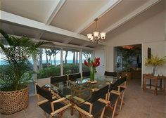 Located on Waimanalo Beach, this crisp white elegant home features designer furnishings, a spacious ocean front yard and a large tropical gated front yard with an Asian inspired lily pond and waterfal...