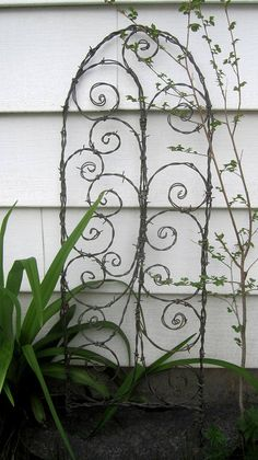 A great Mother's Day gift!    Beautiful Spirals Barbed Wire Trellis Garden Art by thedustyraven, $57.00