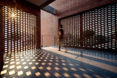 Screens of perforated brick shield the residents of Bangkok's Ngamwongman House, designed by Jun Sekino, from prying eyes of neighbors and passersby.
