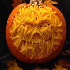 pumpkin expertly carved with to look like exposed muscle from the 2015 This Old House Pumpkin Carving Contest