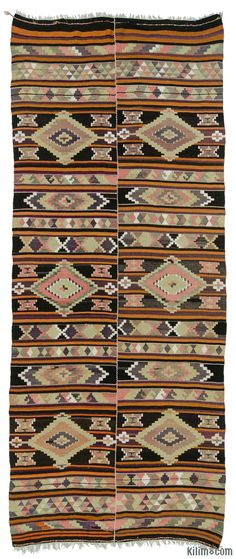 Vintage Turkish tribal kilim hand-woven in Puturge, Malatya in Eastern Anatolia in 1960's. This lovely kilim with two wings is in very good condition. Rug pad recommended. Please contact us if you would like to purchase only one wing to use as a runner.