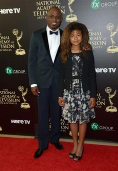 Wayne Brady and daughter Maile Masako Brady arrive at the 41st Annual Daytime Emmy Awards at the Beverly Hilton in Beverly Hills, Calif., on June 22, 2014.