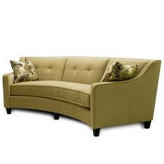 The Sofa Features And Arced Design In A Lovely Mushroom Color This Furniture Piece Seat Cushion Attachment Tailored