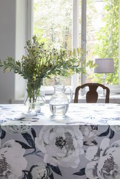 Pioni Tablecloth    Pentik Spring 2018   Blueish Pioni combines the nostalgia of old times with modern colour combinations in a beautiful way. Dark leaves and white flowers create a strong pattern that looks even stronger when combined with dark or blurred colours.