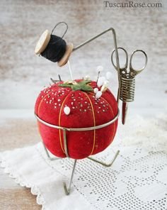 Red tomato pincushion stand