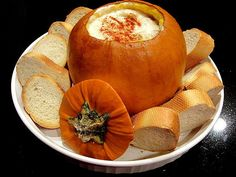 Cheese fondue served in a roasted pumpkin is a show-stopping dish that will set your Halloween party apart from all the others. Guests will love dippi...