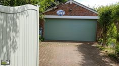 Roller Garage Doors in Chartwell Green are effortlessly stylish & incredible affordable. Electric Garage Doors come in other shades too! Click below to find  your perfect Roller Garage Door.  #garagedoorideas #garagedoordesign #garagedoordecor #garagedoormakeover #garagedoorpaint #garagedoorcolours #garagedoorcolour