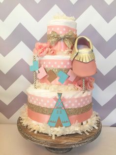 Boho Diaper Cake in Blush Pink, Mint and Gold, Tribal Baby Shower Centerpiece in Pink and Gold by AllDiaperCakes on Etsy https://www.etsy.com/listing/473925385/boho-diaper-cake-in-blush-pink-mint-and