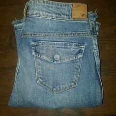 American Eagle Jeans These are American Eagle Jeans.  They are size 2 regular, with a length of about 30.  The style is Stretch.  They are the factory Distressed type as seen by the bottom of the feet and the cool hole in the front.  I think these are pretty bad a... compared to other AE jeans.  Awesome! American Eagle Outfitters Jeans Boot Cut