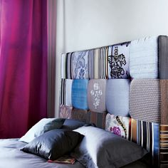 like the use of different fabrics in this headboard.
