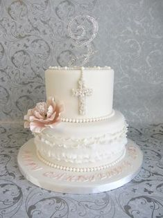 What a beautiful personalized First Communion cake - I love the cross, ruffles, pink flower and sparkly personalized initial on top!
