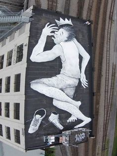 The French pair uses chalk, coal, acrylic paint, and ink to create their street art.