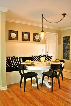 Dramatic Dining Room With Dalmatian Polka Dot Wallpaper In Black And White