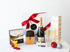 The Luxe Christmas hamper is decadently beautiful, and as Christmas only comes once a year, what better way to celebrate Christmas than with this luxury gourmet gift hamper. Pop the bottle of Moet & Chandon champagne and delight in the sumptuous sweet tastes of Ogilvie & Co. Rum & Brandy Cake, soft creamy Nougat Limar and deluxe Fardoulis chocolates.