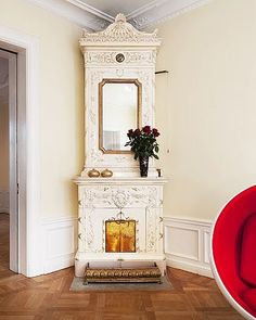 Beautiful Swedish-style stove, with a mantel-like shelf.