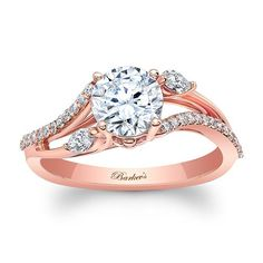 This unique rose gold diamond engagement ring sports a prong set round center diamond. The twisting split shoulders are adorned on opposing sides with a marquise cut diamond and a ridge of shared prong set diamond melee for an elegant flare.<br /> <br /> <br /> Also available in white, yellow gold, 18K and platinum.