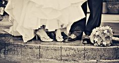 bride and grooms shoes with flowers