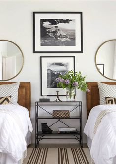 interior cravings - round mirror inspiration and roundup of sources - design by andrew brown - round mirror over twin beds with tan headboards in shared bedroom