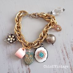 Listing. Repurposed Vintage Gold Charm Bracelet I added some pretty little charms to this vintage gold bracelet. The little pink teacup is adorable. Also a vintage blush and rhinestone button. ChicEVintage Jewelry Bracelets