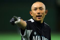 Mariners infielder Munenori Kawasaki looks on during warm-ups before to the preseason game between Seattle and Japan's Hanshin Tigers at Tokyo Dome on March 25, 2012. (Koji Watanabe / Getty Images)