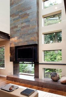 Inside Forest Hill- living room with 2 story see-through fireplace