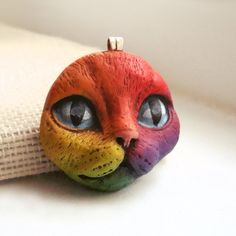 Rainbow Cat Pendant Kitty Face Animal Pet Bright Colorful Polymer Clay Jewelry roygbiv Blue Purple Red Orange Yellow 2764. $14.00, via Etsy.