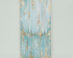 Original 12x24 Abstract painting with neutrals and light teals and accented with gold foil Painting is protected with a high-gloss finish   Great price for a statement piece that would fit well in any room  This painting can also be reproduced on a different size canvas. Please contact for pricing. The pictures of a finished artwork will be sent before shipment.   Each painting I create is one of a kind, containing different brush strokes, texture, and color. Each painting will be signed in…