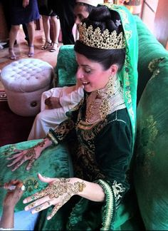 Moroccan brides often wear an elaborate kaftan and heavy jewelry to show the wealth. The brides as well as female guests make up their hands with henna