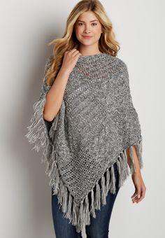 thick cable knit and open stitched poncho with fringe