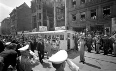 """'Ich bin ein Berliner' - Striding past a cordon of saluting servicemen at Checkpoint Charlie, President John F. Kennedy arrives in Berlin on June 26, 1963. Kennedy delivered one of his most famous speeches, declaring, """"Ich bin ein Berliner"""" - or """"I am a Berliner"""" - to a cheering crowd of thousands. The much-needed morale boost for West Berliners also sent a strong message to the Soviets. Two months later, Kennedy negotiated the first nuclear test ban treaty with the Soviet Union."""