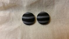 """Handmade fabric button earrings featuring gray and black stripes. Available in 3/4"""". Each earring is unique and may vary slightly from the picture shown."""