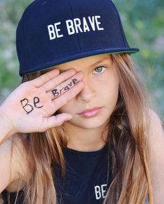BRAVERY IS BEAUTIFUL... We love this powerful shot of beautiful Milla making a bold statement! Thank you @wendyhortonphotography ashlynhairandmakeup & @princesisters2 #bebrave #bebold #befearless #braveryendsslavery #izzybeclothing #izzybe #fashionphotoshoot #fashionwithpurpose #tweenmodel #enditmovement #endbullying #endslavery #shoptostopit