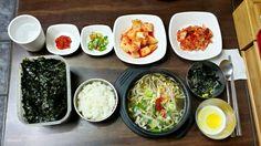 콩나물국밥, Bean Sprout and Rice Soup Looking good? This is full set of Bean sprout soup and banchan. There is important process you need to follow. let's check it out. What is the menu here? Main dish A. Rice B. Bean Sprout and rice soup C. Half boiled egg D. sliced seaweed Side dish A. Ggakdugi(Cubed radish kimchi) B. Kimchi C. Cheongyang pepper D. Salted and fermented squid How to eat? A. Put some sliced seaweed into egg cup B. Mix seaweed and egg in the cup, then drink all C. Feel the taste…