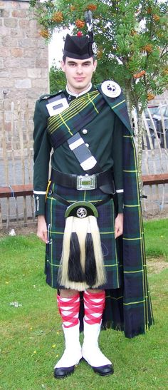 Full Dress is based on the old Gordon Highlander uniforms,   This was at the Aboyen Highland Gathering near Aberdeen, where the massed pipes and drums of the Gordon Highlanders marched the clans to the games, and provide a small tattoo.