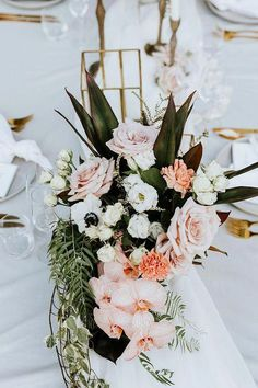 a tropical wedding centerpiece of roses, anemones, orchids and greenery and leaves centerpieces orchids Tropical Wedding Centerpieces, Wedding Reception Centerpieces, Flower Centerpieces, Wedding Bouquets, Wedding Decorations, Tropical Weddings, Wedding Backdrops, Reception Table, Centerpiece Ideas