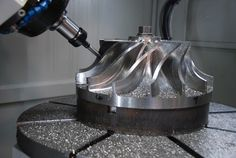 5 Axis CNC Machine http://sircomachinery.com/CNC-verricals-horizontals-lathes-rotaries-sirco.html.  I'm filled with so much WANT!
