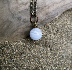 *the details*    A simple necklace adorned with one blue lace agate gemstone on a 28 chain. The chain, lobster clasp, and other findings are a