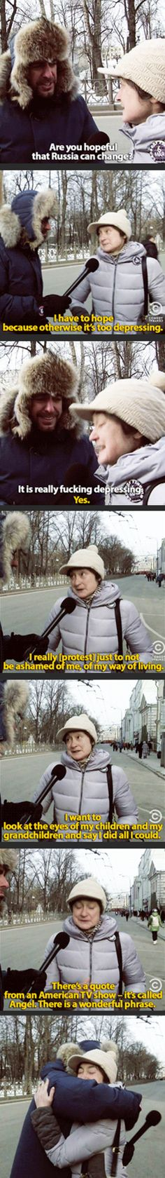 Jason Jones talks to a Russian woman protesting…