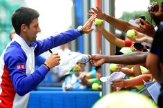 Novak Djokovic in a 10 and Under Tennis clinic on the grounds of the 2012 US Open. - Rob Loud/USTA
