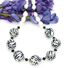 Black and white is such a classic combination - a combination that every woman needs in her jewelry collection. The WILD THING handmade necklace fits that perfectly - and adds wild, animal patterned fun into the unique mix!