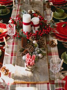 Christmas Decor. Christmas Tablescape. Red and Green Place Setting. Reclaimed Wood Table Runner. Holly Berries. Pine Cones. Candy Canes. Traditional Theme.