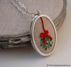 Hand Embroidered Mistletoe Pendant in red and green on natural linen fabric by September House