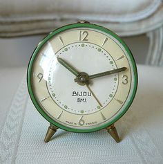 Granny - reminds me of sleeping in the big bed at Granny's - the same green shiny eiderdown with a similar noisy tick clock on the bedside table Vintage Love, Vintage Green, French Vintage, Vintage Alarm Clocks, Old Clocks, Vintage Antiques, Vintage Items, Vintage Interiors, Green Clocks