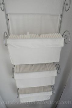 Ikea magazine rack (turned into a diaper holder) -- Although Im doing cloth diapers I wonder what else this could be used for. So many possibilities ;)