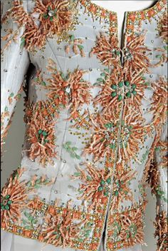 Valentino Haute Couture Spring / Summer 2004 jacket fashioned from mauve colored crocodile, embroidered with floral design using branches of peak d'ange coral, jade cabochons, Swarovski stones, rhinestones, emeralds, and gold bugle beads.