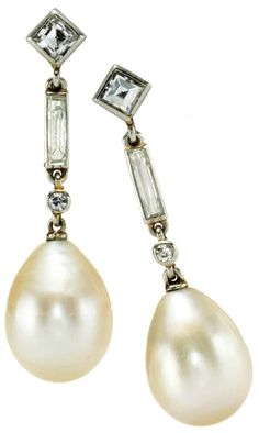 Cartier Art Deco Pearl Drop and Diamond Ear Pendants, each hung with a drop Pearl below an articulated collet set line of small round Diamond, Baguette Diamond and Oblique set Square Diamond top, Mounted in Platinum, Paris, Circa 1925. Accompanied by SSEF report number 64932 stating that the Pearls are Natural and of Saltwater Origin. Via 1stdibs.