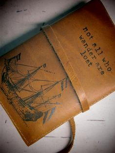 Leather journal or sketchbook featuring ship and not all who wander are lost with free personalization.