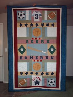 My daughter-in-law and I designed this sports quilt for my oldest grandson; then I made and quilted it!
